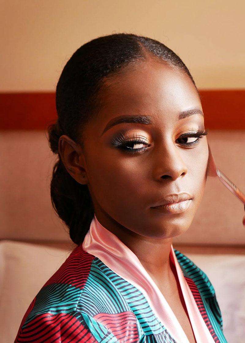 beautiful woman makes makeup